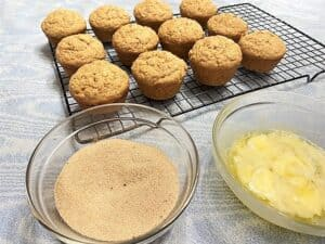 Dipping Muffin Tops in Cinnamon Sugar Mixture
