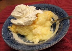 Serving Lemon Pudding Cake with Whipped Topping