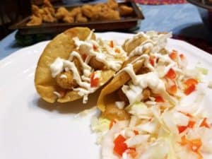 Serving Fish Tacos with Lime Crema