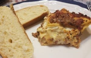 Serving Homemade Lasagna with Ricotta Cheese