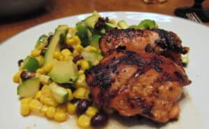 Serving Grilled Chicken Thighs with Corn and Black Bean Salad