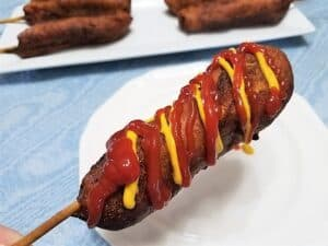 Serving Corn Dogs Slathered in Ketchup and Mustard