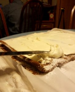 Filling Yule Log with Cream