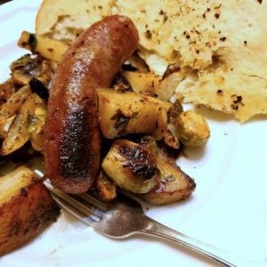 Serving Bratwurst with Roasted Vegetables and Gnocchi