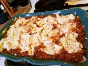 Assembling Homemade Lasagna in Dish