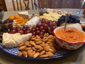 Charcuterie board with roasted red pepper tapenade