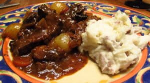 Serving Beef Bourguignon with Mashed Potatoes