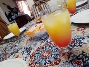 Serving Breakfast Ambrosia with Pineapple Orange Tequila Sunrise