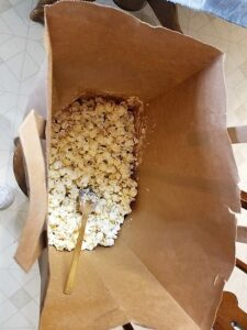 Mixing the Popcorn in a Paper Bag